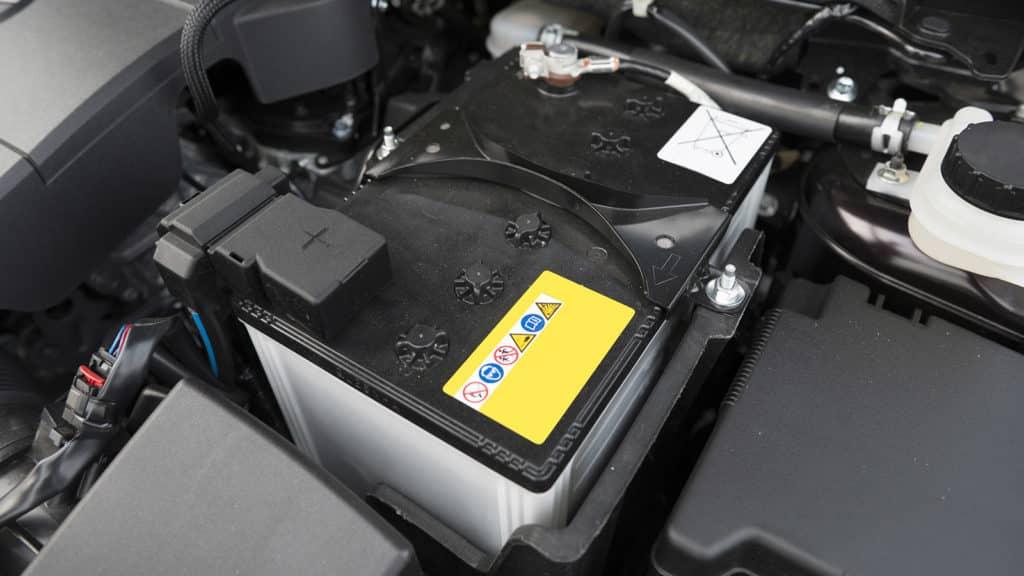 Car battery under the hood.